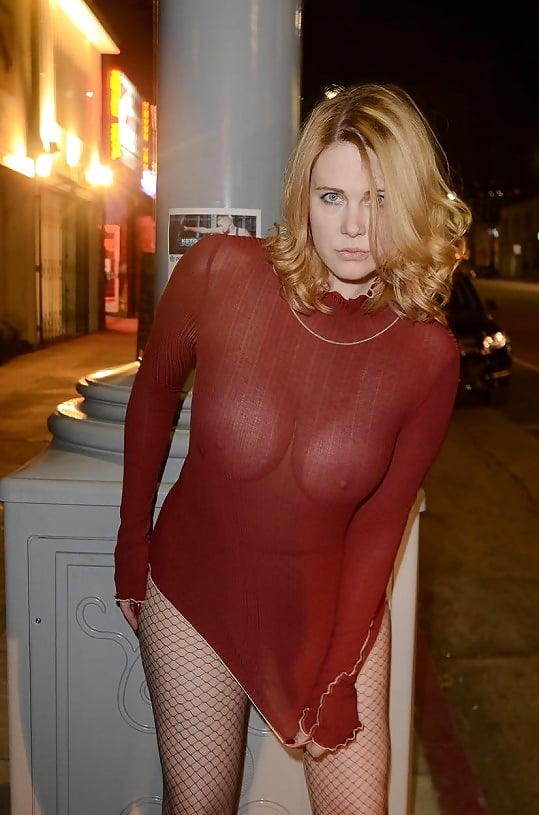 Posing with her nipples poking in her transparent dress