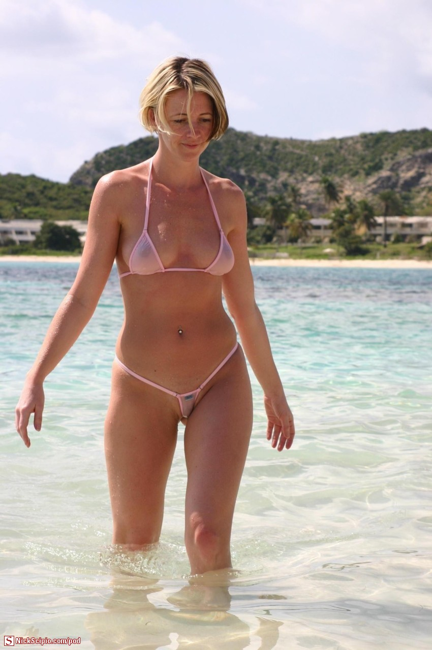 Almost nude in her wet transparent micro bikini