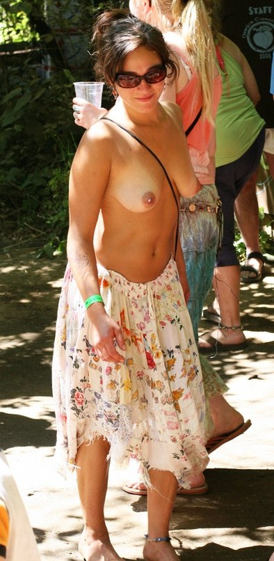 Posing topless in a public place wearing only a skirt