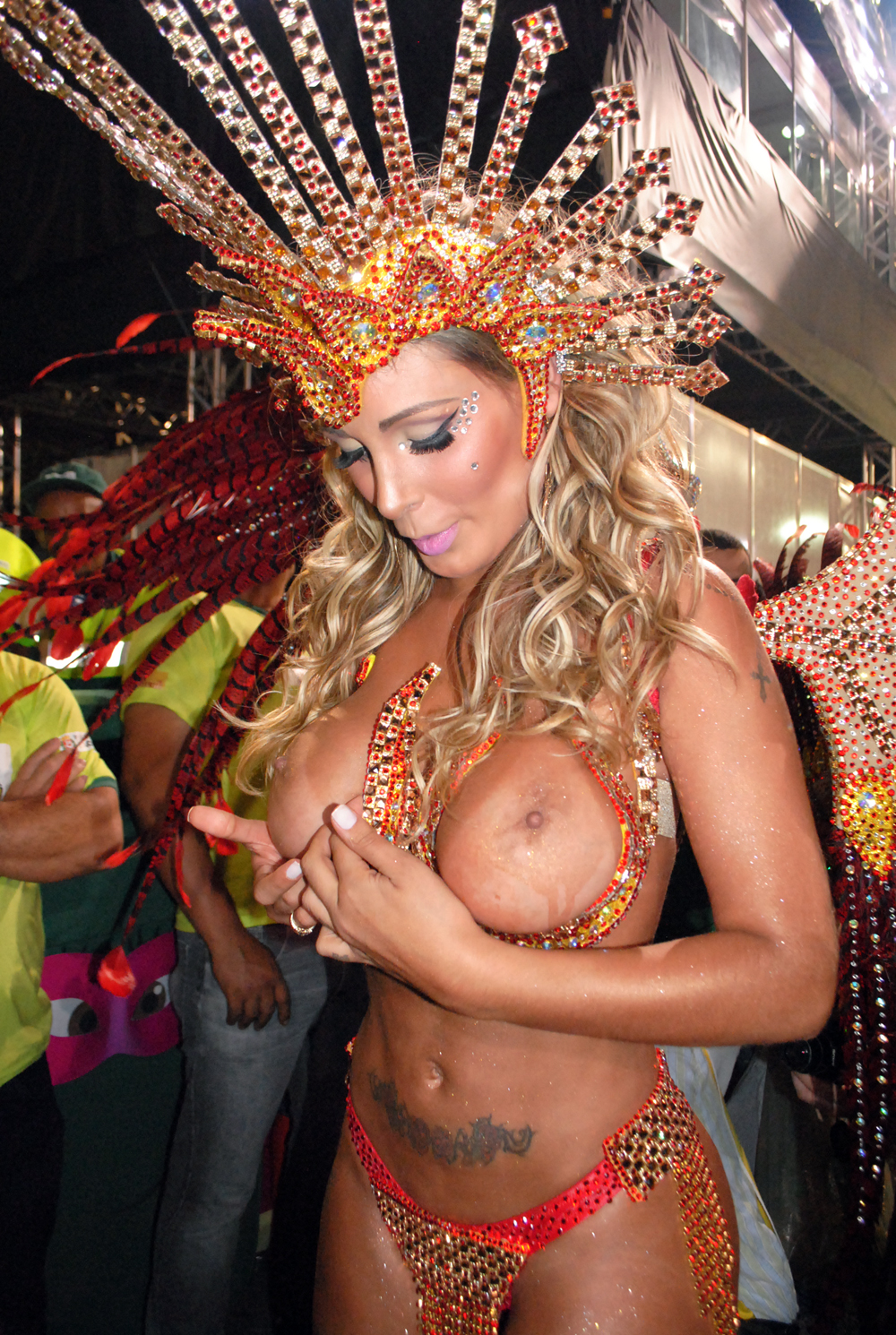 Andressa Urach posing almost topless in a carnival and showing off her big boobs